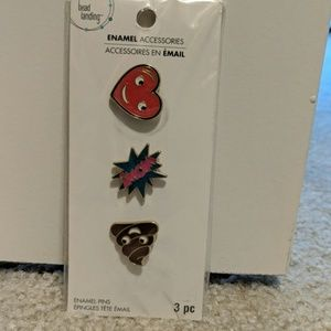 Enamel pins. Heart, wow comic, poop.